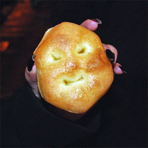 An Italian mini-pizza in which holes in the crust give it an appearance of a face.